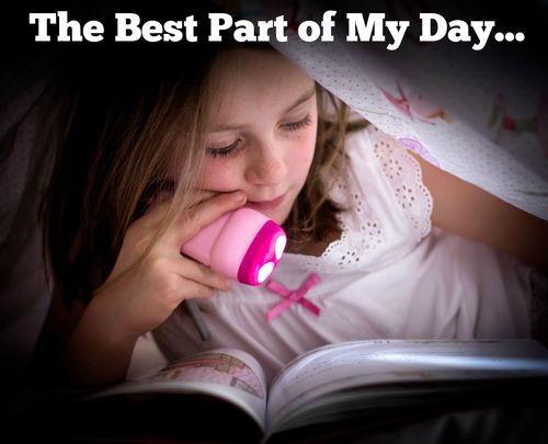 kid reading under the blanket
